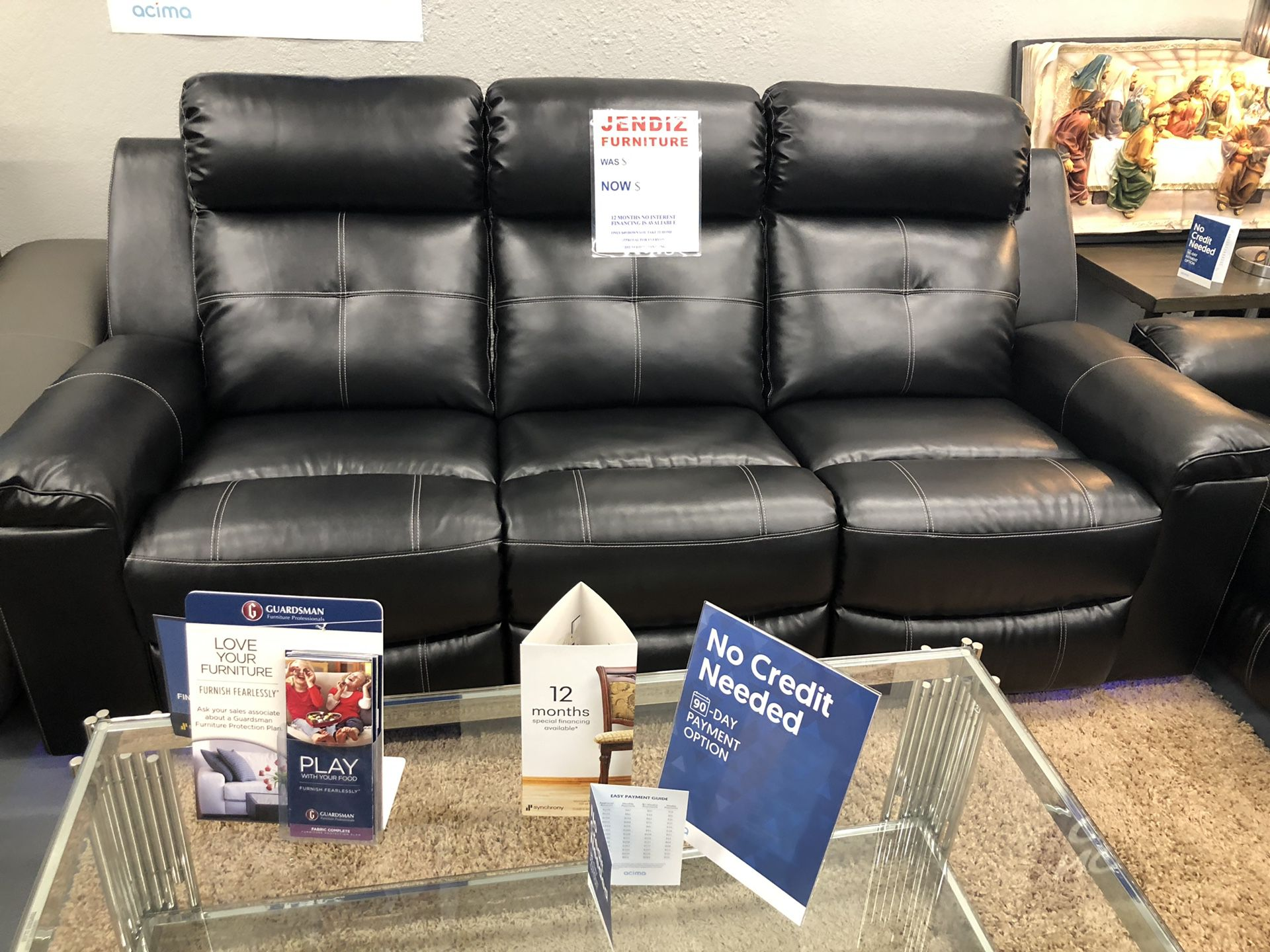 Brand new black leather reclining sofa and loveseat