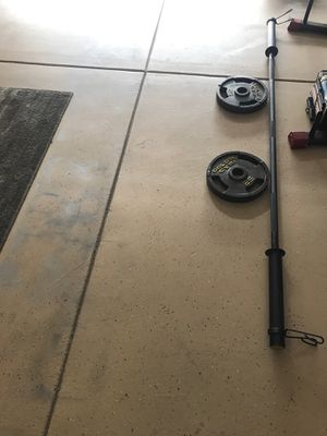 Photo 7!feet golds gym olimpic bar n weights. $150 serious buyers only.
