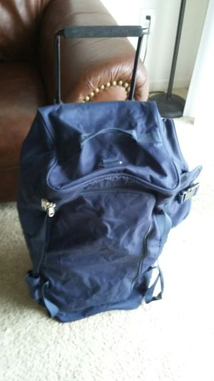 NICE LARGE TRAVEL BAG WITH WHEELS FOR EASY TO MOVE. LIKE NEW EXCELLENT CONDITION for Sale in Falls Church, VA