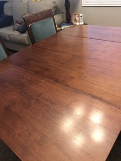 Antique dining table and 6 chairs. Slight repair needed on one chairs upholstery coming loose from frame. Thumbnail