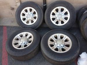 Photo Set of f250 super duty 18 inch alloy rims, caps, and lug nuts 8 on 170