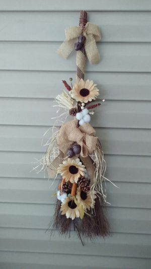 Cinnamon broom decorated in beige flowers and burlap ribbon. for Sale in Rustburg, VA