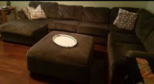 Ashley sofa sectional- light brown- no pets - no smokes - 1 years and half . Clean and good condition. Ottoman in photo is included for Sale in Manassas, VA