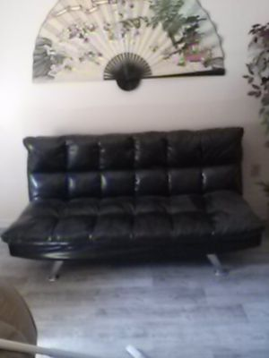 Photo This is a click clack bed/couch its vinyl no tears. Just sits and collects dust cost was 300 plus financing...farmers still sells it.fan goes with it