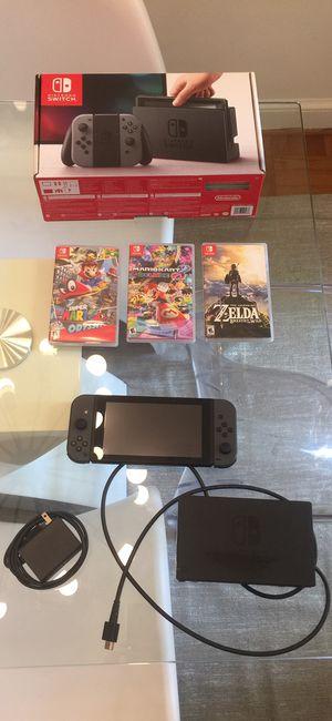 Nintendo Switch including Zelda, Mario Kart Deluxe 8, Super Mario Odyssey, plus memory card for Sale in Washington, DC