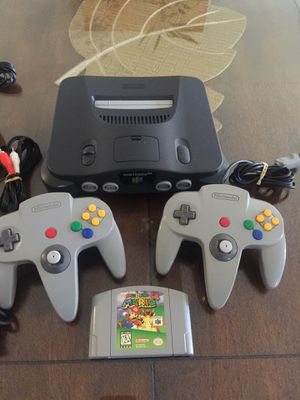 Photo Nintendo 64 w Super Mario 64 w 2 original Controllers and Cables