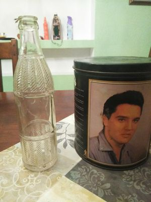 1925 soda bottle and Elvis can biography on the 60 . for Sale in Port Richey, FL