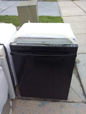 Photo Black whirlpool dishwasher with plastic tub in excellent working condition
