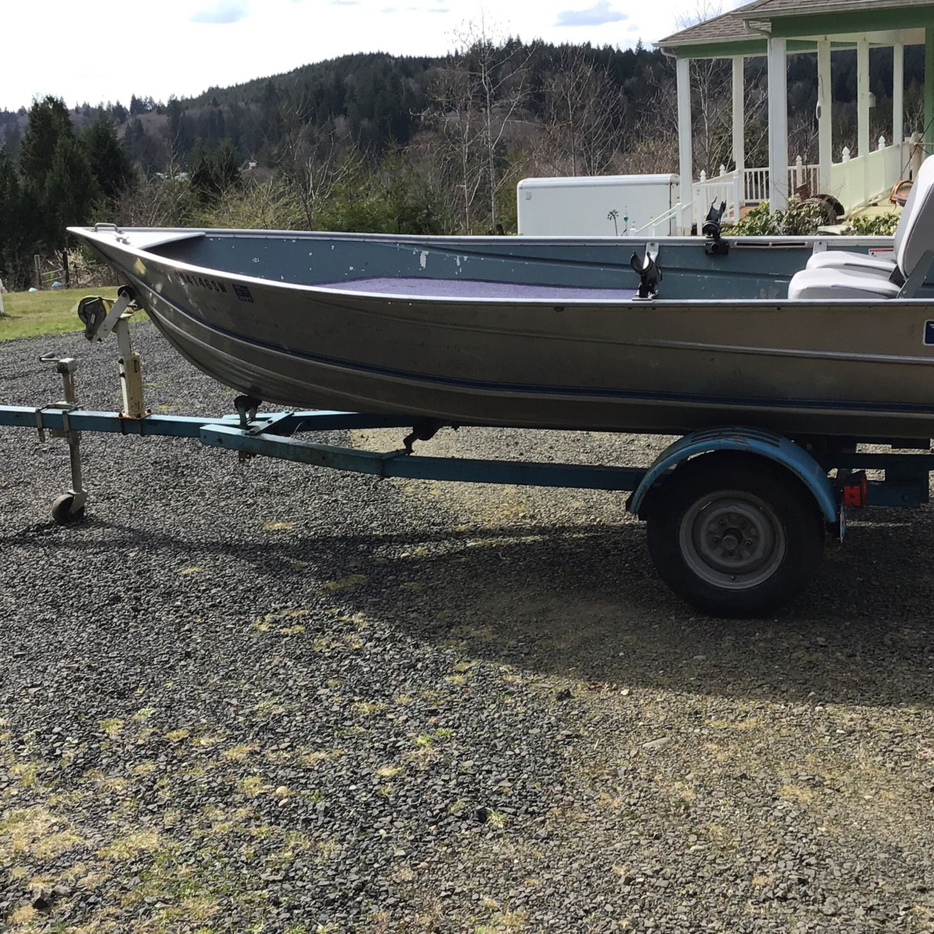Photo 14 Foot Westcoaster Boat With Trailer. 2 New Seats, New Casting Deck with carpet, 2 rod holders, 2 oars. New Bearings On trailer. No leaks,.