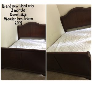 Queen size wooden bed frame for Sale in Henrico, VA