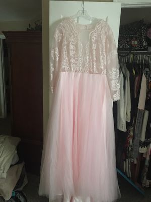 Brand new pale pink wedding gown, size 12. Never altered or worn. Pink lace bodice, open back and tulle gown. for Sale in Indianapolis, IN
