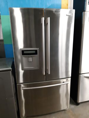 Photo Kenmore stainless steel counter depth french Doors fridge in exelent condition