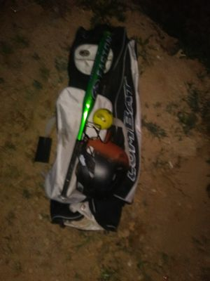 Baseball bat bag wth a helmet a softball and a nice Easton green v at 30inch for Sale in Phoenix, AZ