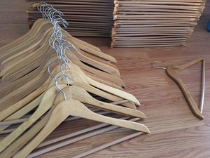 Set of 90 light maple wood hangers for Sale in Morgan Hill, CA