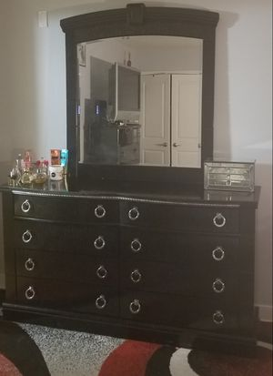 Ashley dresser with mirror and 5 dresser drawer. Will have items delivered to you for an additional cost. Plus, if you like the area rug it's free! for Sale in Washington, DC