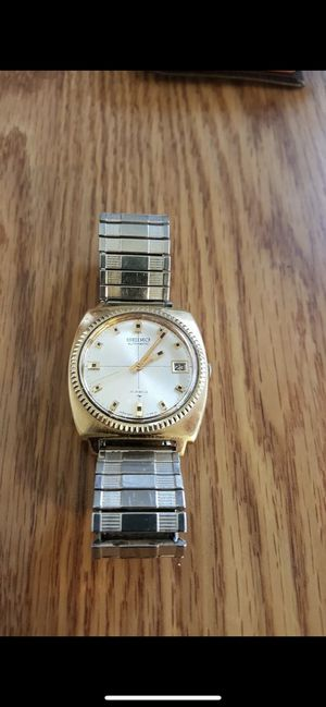 Photo Seiko automatic gold tone vintage coin bezel watch