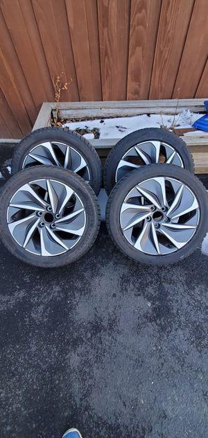 Photo 2019 honda rims with snow tires 235/45R17