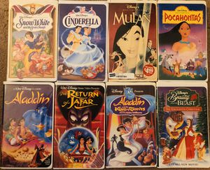 Photo Disney VHS movies (33 total) with TV/VCR combo