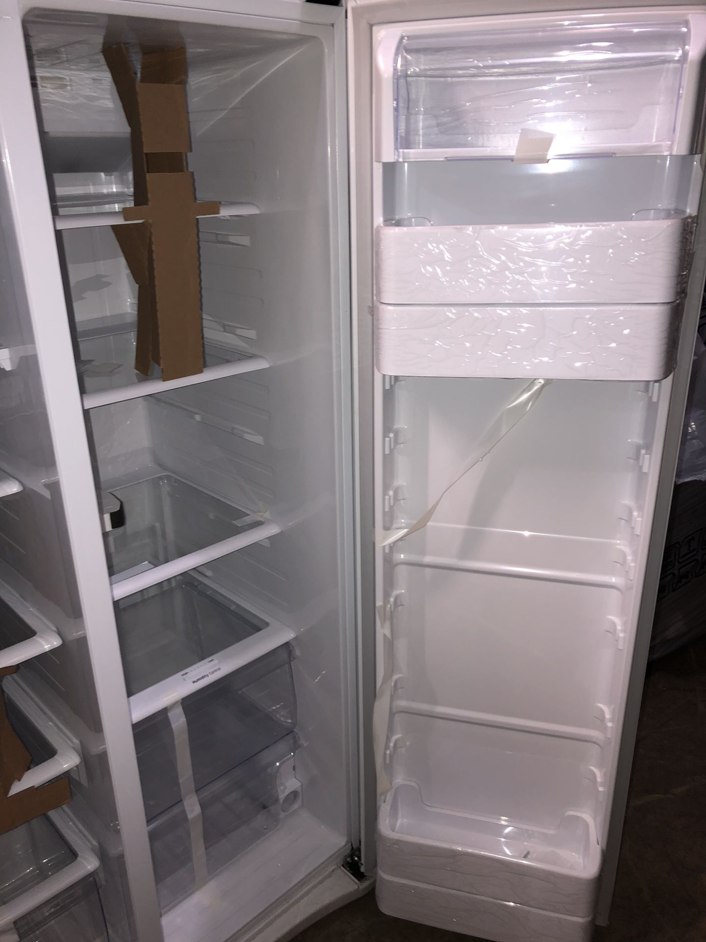 samsung white side by side fridge with water/ice dispenser