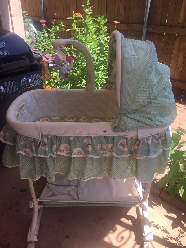 like new winnie the pooh bassinet with mobile and storage for sale