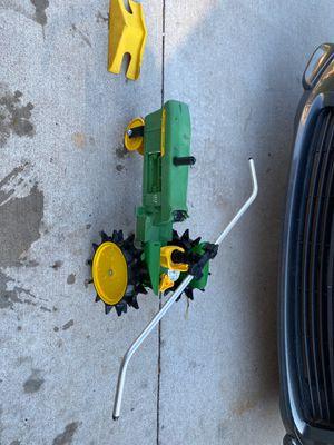 Photo John Deere 4010 lawn sprinkler