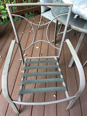Patio table and 4 chair set. Pillows not in a great shape. for Sale in Annandale, VA