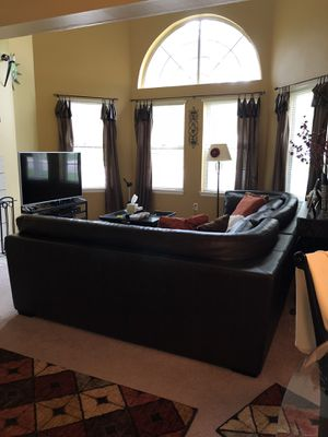 Brown Leather Sectional w/ Ottoman At the back of sections 2 each 77x40 Ottoman 3ft x 3ft for Sale in Lone Tree, CO