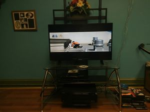 Tv flat scream with nice glass stand I believe tv 38 in for Sale in Martinsburg, WV
