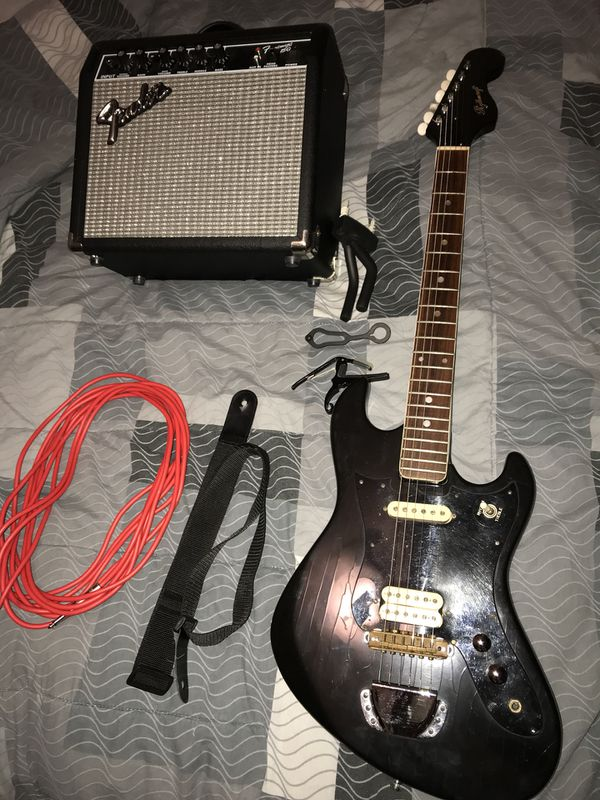 Vintage japan electric guitar with cord strap fender amp an wallmount an  capo for Sale in Houston, TX - OfferUp