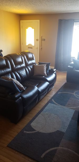 Photo 2 piece living room recliner set. Chocolate/dark brown in color. The middle cushion is a little sunken in .