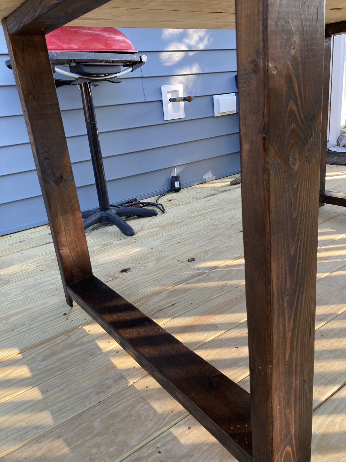 Inside/ outside weather treated wood table