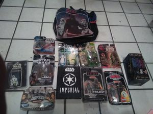 COLLECTABLE STARWARS TOYS WITH TRILOGY, IMPERIAL HANDBOOK AND MATCHING BACKPACK!! for Sale in Phoenix, AZ