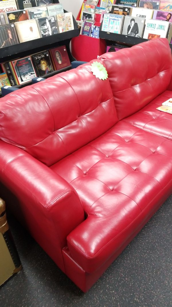 7 foot red sofa. Leather blend (pleather) nice! Reduced price for ...