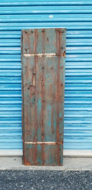 Photo Rustic wood door wall hanging. It has 2 hooks on the back to hang on a wall.