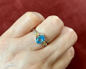 Created blue topaz engagement ring wedding ring size 8 sterling silver and 18k gold plated heart knot for Sale in Richmond, VA