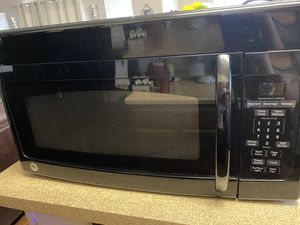 Photo Microwave GE black over the stove