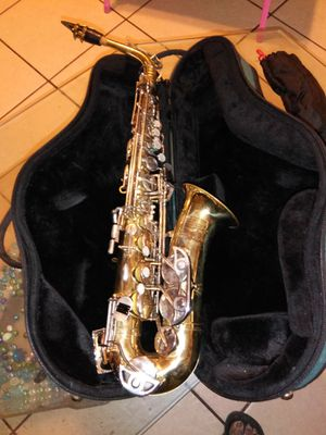 Saxophone for junior high and high school kids plus extra strap music book stand all for 200 for Sale in Las Vegas, NV