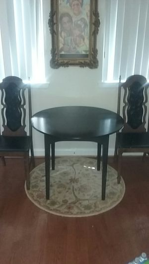 Small black kitchen table with two antique chairs for Sale in Gaithersburg, MD