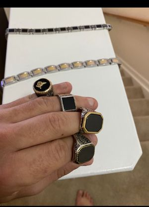 Photo Mens real gold and diamond bracelet and rings, black/gold/silver