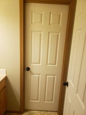 Photo Interior door, door knob and brackets.