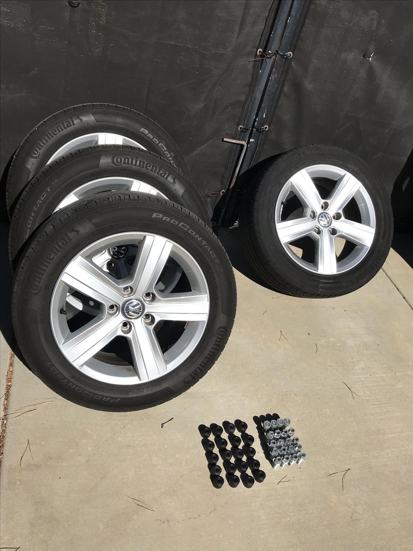 """16"""" VW Rims & tires. W/ lugnuts /bolts"""