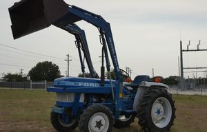 1710 Ford with-Bucket 770a for Sale in Arlington, TX