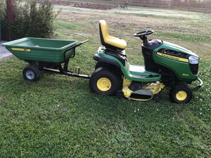 Photo John Deere D140 22-HP V-twin Side By Side Hydrostatic 48-in Riding Lawn Mower.