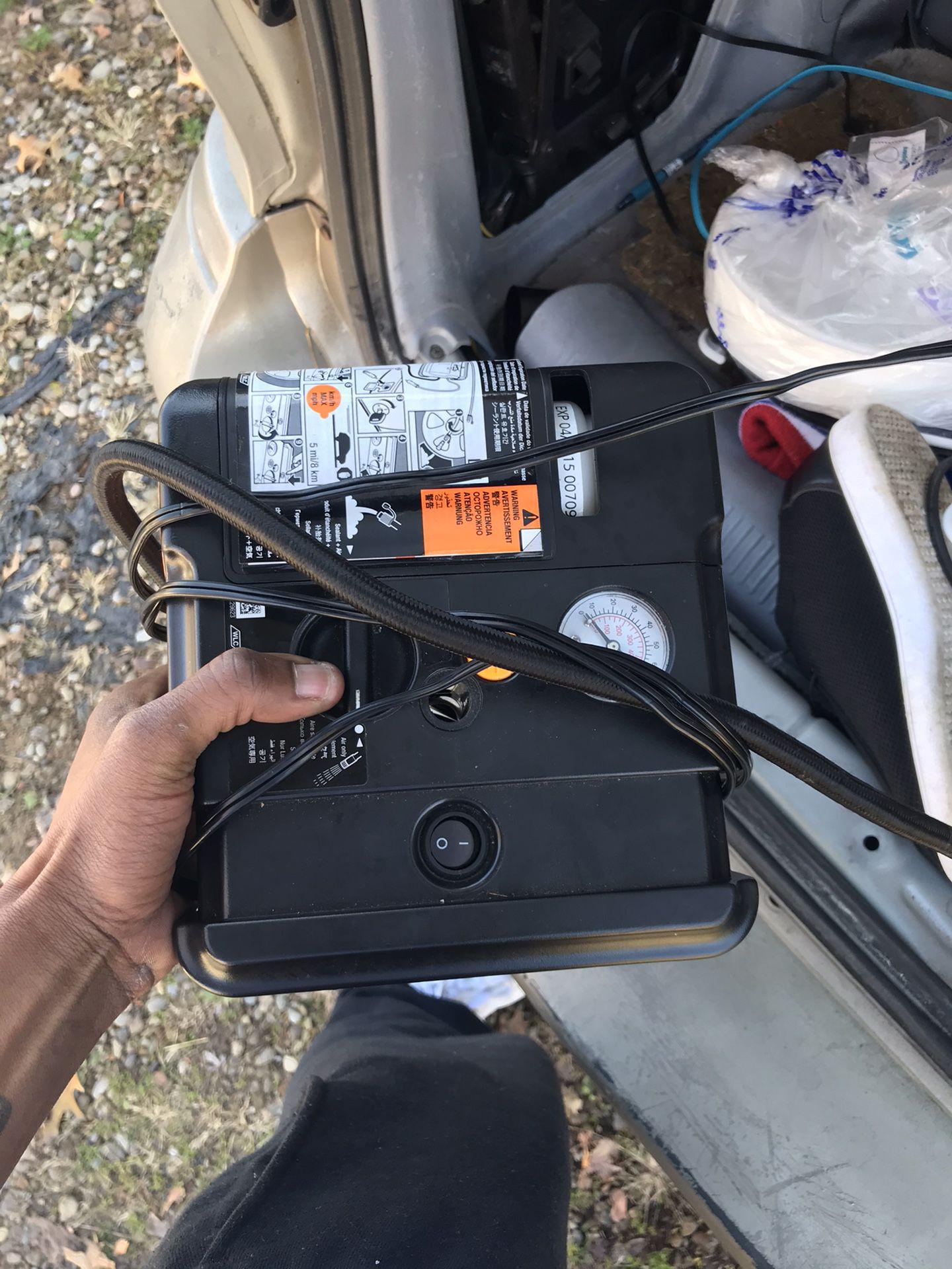 Cigarette lighter air pump