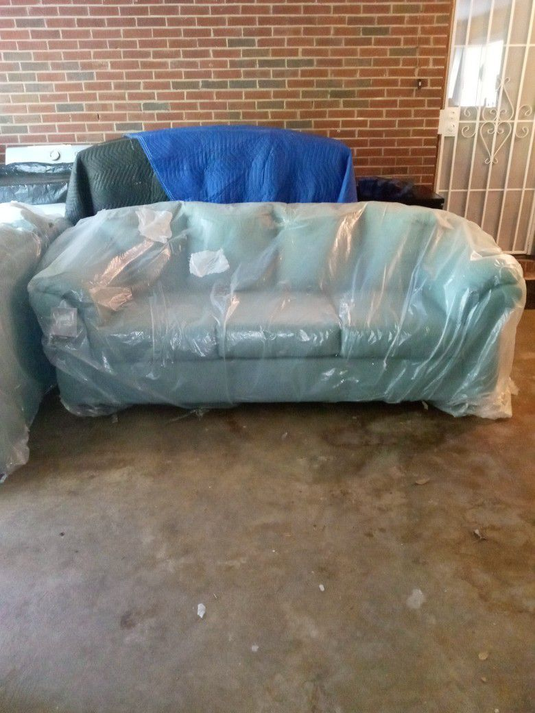 Brand New  (Darcy) Couch and Loveseat by Ashley Funiture