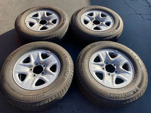 "Photo (4) 18"" Toyota Tundra Wheels + 255/70R18 Michelin - $350"