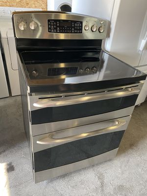 Photo 2 year old ge electric Glasstop double convection Stainless can deliver Really nice profile double oven five burner electric Glass Top retails at ab