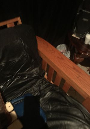 Nice clean oak wood with leather over the cushion futon for Sale in Bryans Road, MD