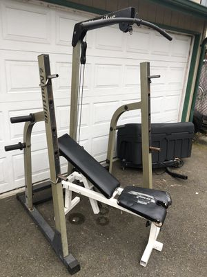 Photo Nautilus squat rack & bench Used comes with lat bar row bar for pulley system