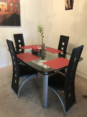 IKEA glass dining table for Sale in Potomac Falls, VA
